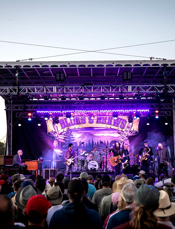 Flagstaff Blues and Brews concert - band on stage watched by crowd.